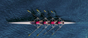 professional rowing team in boat